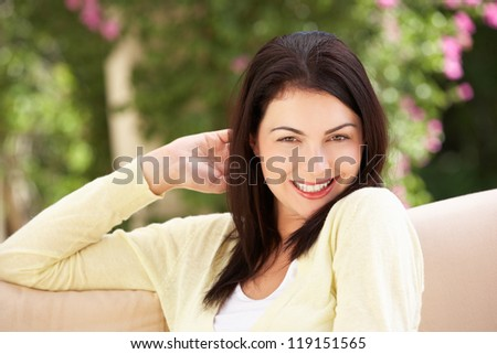 Woman Relaxing On Sofa At Home - stock photo