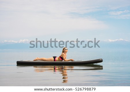 woman relaxing on sup