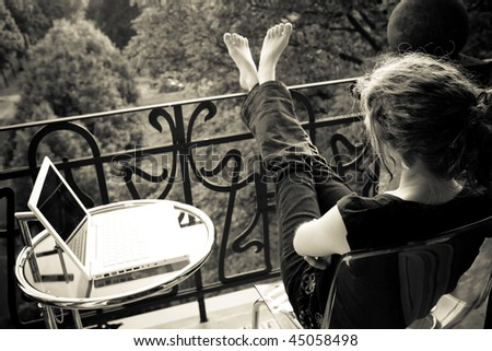 woman relaxing on the balcony - stock photo