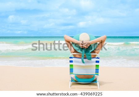 Woman relaxing on the beach.  - stock photo