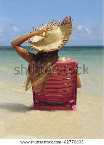 woman relaxing on the beach - stock photo