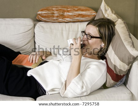 woman relaxing on the couch - stock photo
