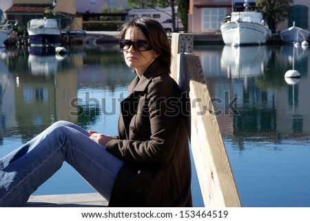 Woman relaxing on the pier