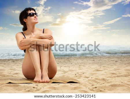 woman relaxing on the sea - stock photo