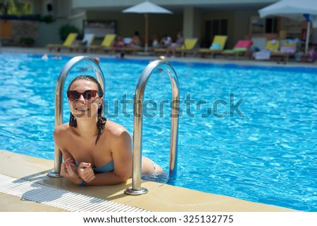 Woman relaxing on the swimming pool