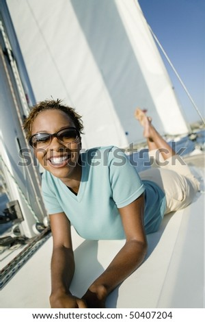 Woman relaxing on yacht, (portrait) - stock photo