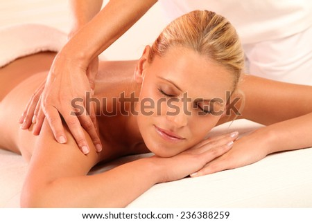 woman relaxing while massage - stock photo