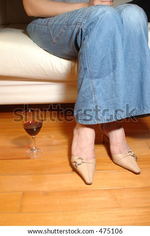 woman relaxing with a glass of wine - stock photo