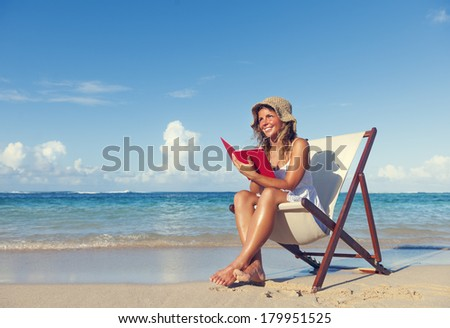 Woman Relaxing with Book On Beach