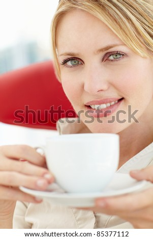 Woman relaxing with cup of tea - stock photo