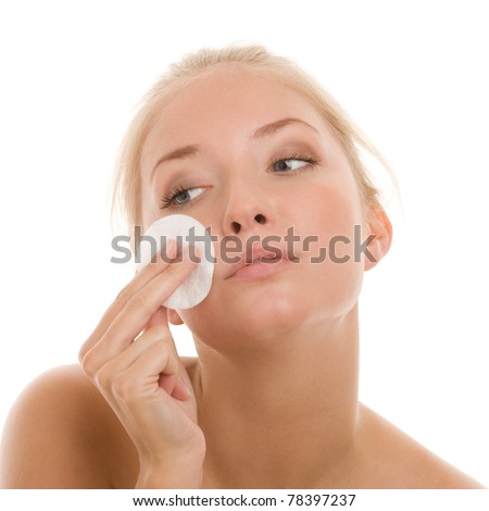 Woman removing makeup with cleansing pad - stock photo