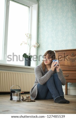 Woman renovating and relaxing with a cup of tea - stock photo