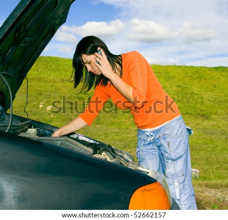 woman repairing the car - stock photo