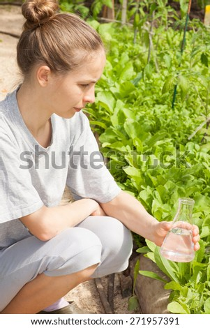 woman researcher testing the water quality - stock photo