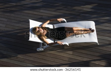 Woman resting and having a sun shower