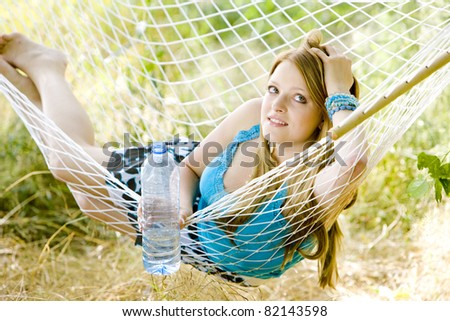 woman resting in hammock - stock photo