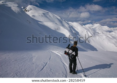 Woman resting in snow covered mountains - stock photo