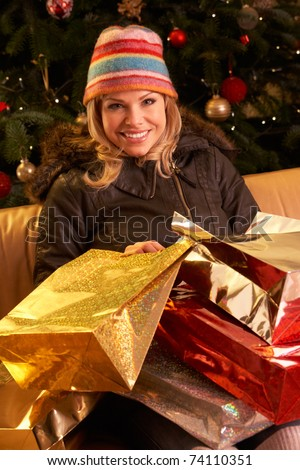 Woman Returning After Christmas Shopping Trip - stock photo