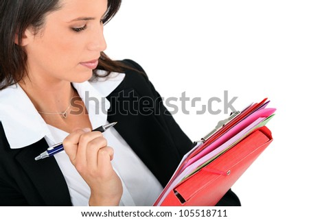Woman reviewing notes - stock photo