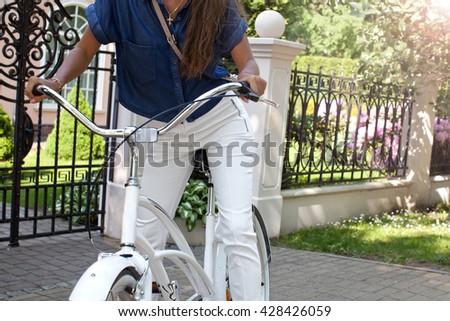 Woman riding bicycle  - stock photo