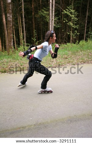 Woman roller blading in a demonstration forest built for no vehicles - stock photo
