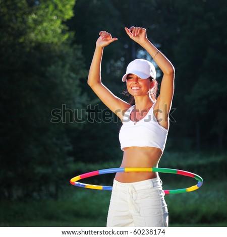 woman rotates hula hoop - stock photo