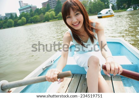 Woman Rowing Boat - stock photo
