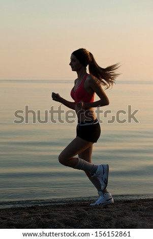 Woman run on beach near water