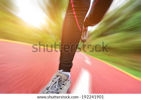 woman runner athlete legs running on road. woman fitness jogging  workout wellness concept.   - stock photo