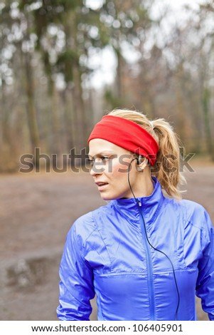 Woman runner exercising in winter forest - stock photo