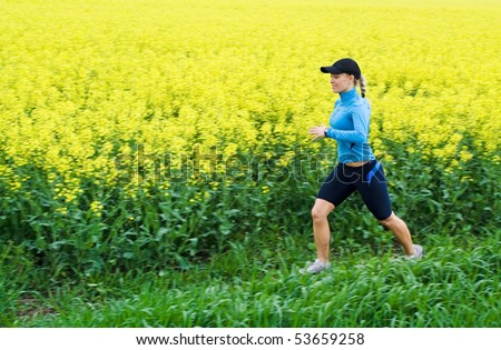 Woman runner running outdoors in spring, motion blur - stock photo