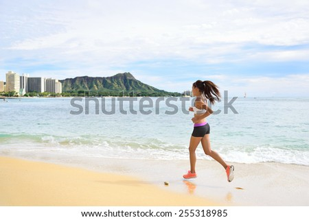 Woman runner - Sport running fitness girl jogging on beach run Female athlete jogger training living healthy active exercise lifestyle exercising outdoor on Waikiki Beach, Honolulu, Oahu, Hawaii, USA. - stock photo