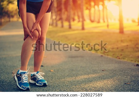 woman runner sports injured leg  - stock photo