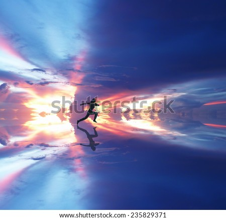Woman running against coloured sky - stock photo