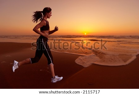 woman running during sunset - stock photo