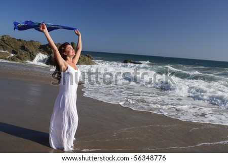 Woman running in to the waves