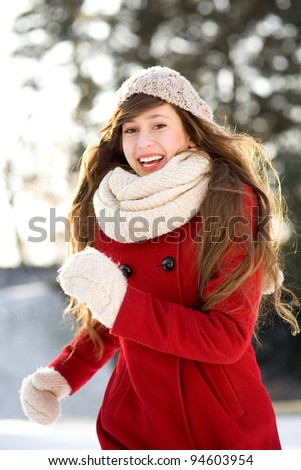Woman running in winter scene - stock photo
