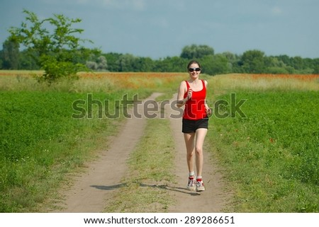 Woman running on a field