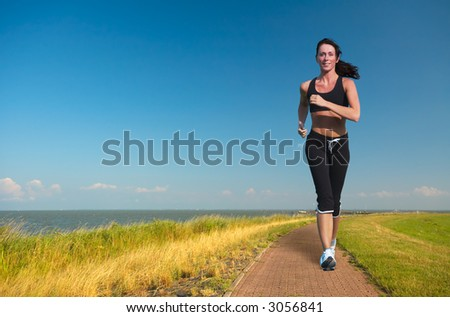 woman running  on a summer day - stock photo