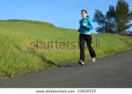 Woman running on a trail - stock photo