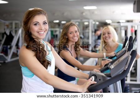 Woman running on a treadmill/Running on a Treadmill - stock photo