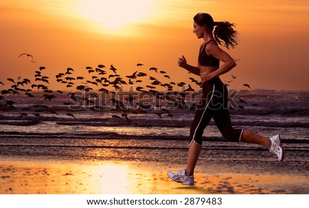 woman running on the beach and sunset - stock photo