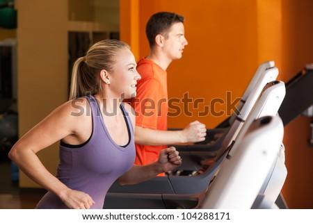 Woman Running on Treadmill - stock photo