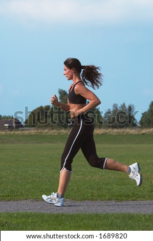 Woman running outdoor - stock photo