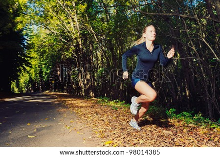 Woman Running Outdoors with Motion Blur - stock photo