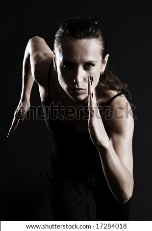 woman running over dark background - stock photo