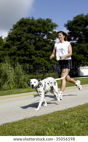 woman running with dog - stock photo