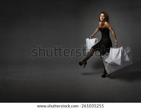 woman runs with lot of bags
