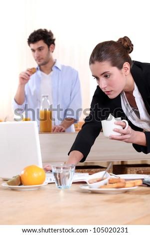 Woman rushing through breakfast - stock photo