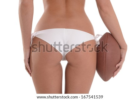 Woman's Backside Holding Football  - stock photo